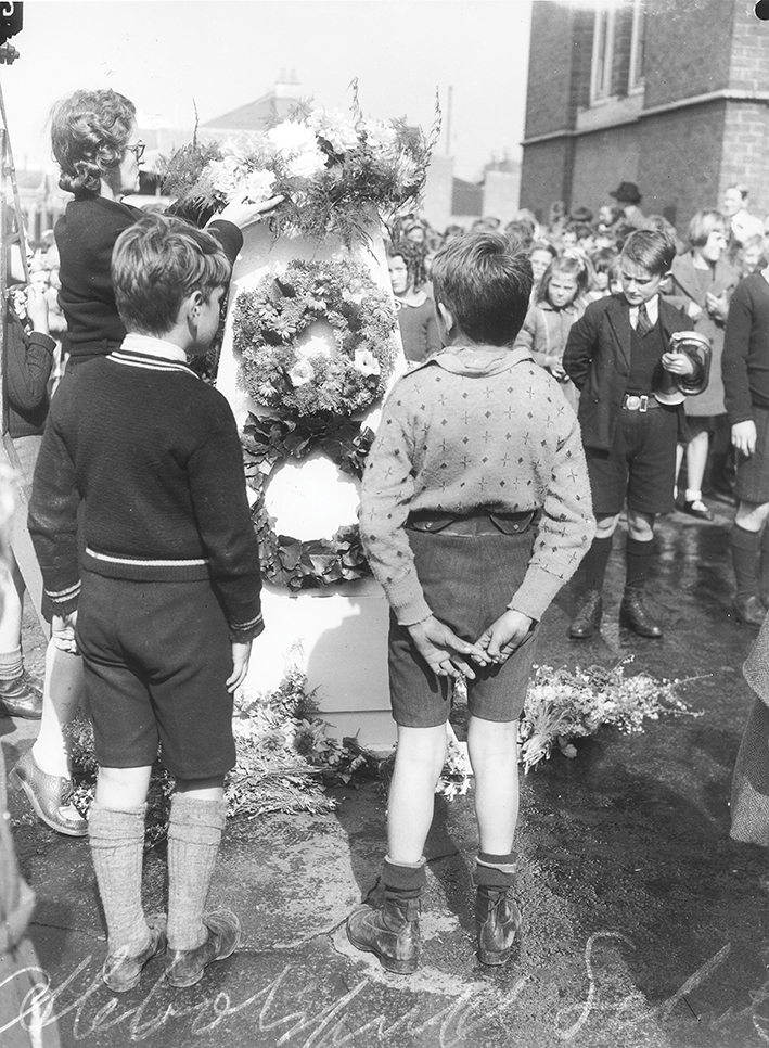 Two young boys standing at an Anzac Day ceremy at a school in Abbostford