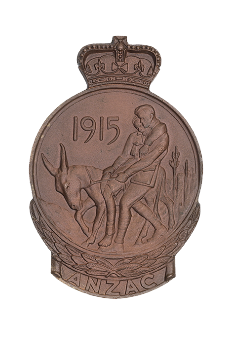 Anzac Medallion showing the year 1915 and a soldier holding another soldier on a donkey