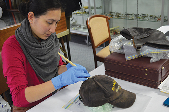 Women completing mould treatment on a hat