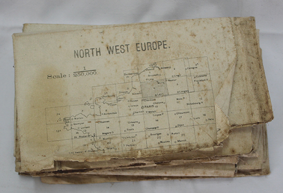 North West Europe map and other papers with discolouration and damaged edges