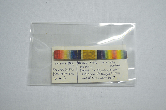 Medal ribbon above hand written labels
