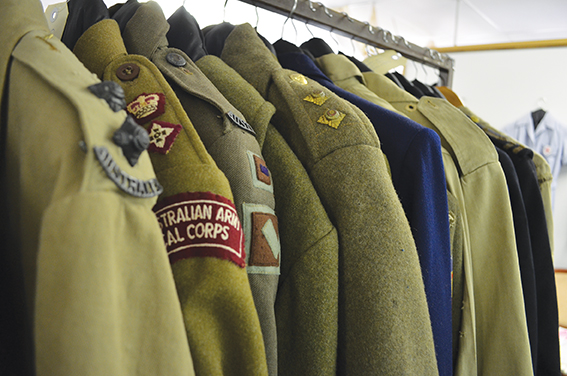 Military uniforms hanging together