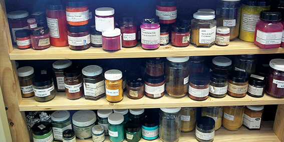 Shelves of colourful dry pigments