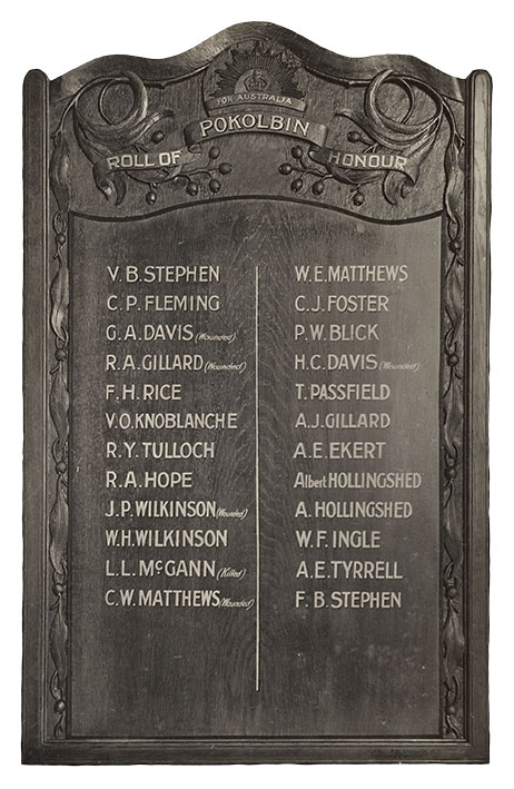 A decorative crafted board with listing of names grouped in 2 columns