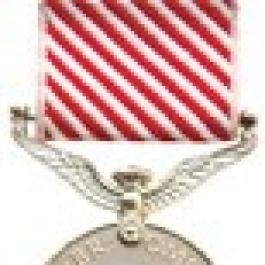 Air Force Medal—a coin-like silver medal which hangs on a white-and-red diagonally striped ribbon.